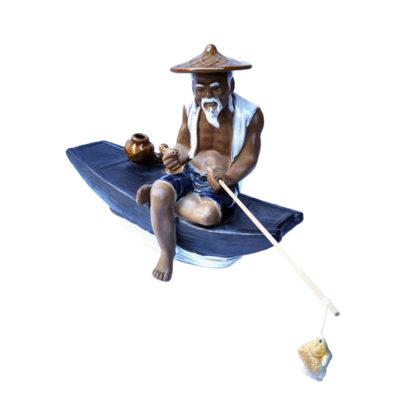 """Фарфоровая статуэтка """"Китайский рыбак на лодке"""""""